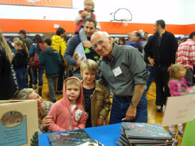 Susanna shared a table with her husband, children's book author Gary Golio, shown here with a few of the 7,000 attendees.