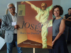 Susanna and Raul Colón. Each Rivera Award-winning author and illustrator carried a giant poster of their books cover.