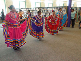 The girls in this traditional folk dance group wore brightly-colored dresses.