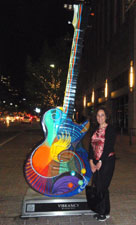 Susanna spoke about her forthcoming Beatles book, then posed with a giant guitar on Congress St. in Austin