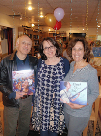 Gary Golio, Voracious Reader owner Francine Lucidon and Susanna at the Stand Up and Sing! signing and sing-along.