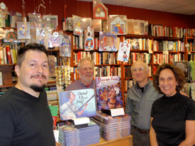 Illustrator Adam Gustavson, Village Bookstore owner Roy Solomon, Gary Golio and Susanna at the Stand Up and Sing! book launch.